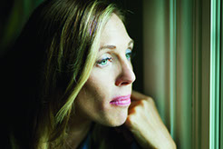 picture of depressed woman staring out of window